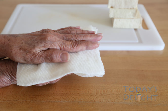 place paper towel under and above tofu