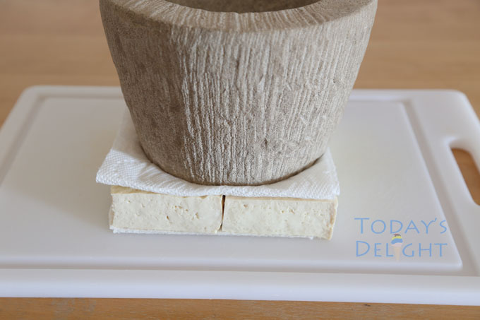 weigh tofu with something heavy