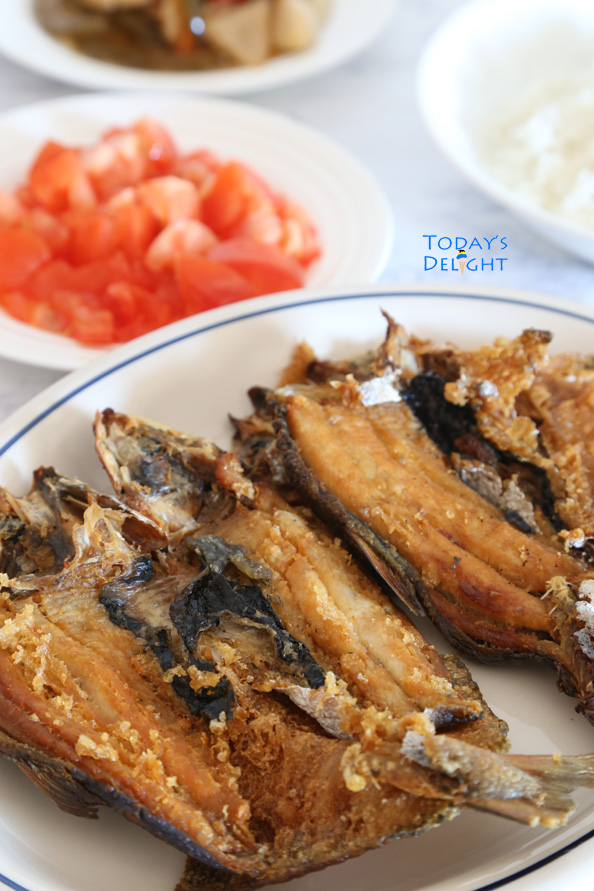 Cooking fried bangus is Today's Delight