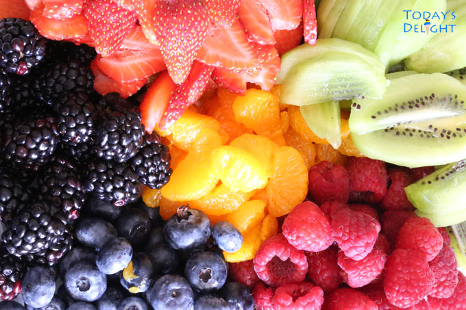 an array of vibrant fruits as topping for a fruit tart