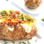 Fluffy Baked Potato with classic toppings is Today's Delight.