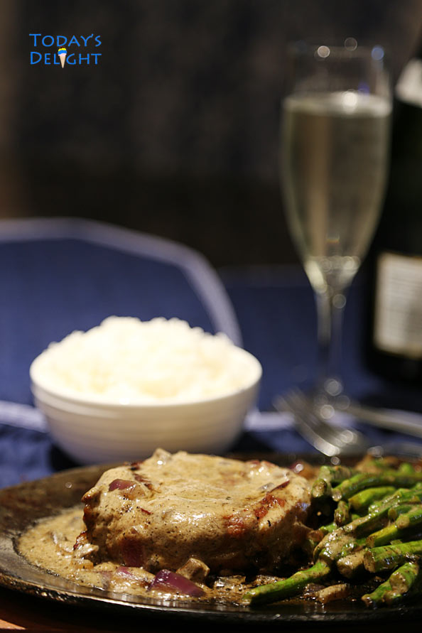 Rib Eye steak with side and a glass of wine