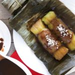 Suman sa Lihiya, a Filipino sticky rice dessert with coconut caramel sauce and grated coconut.