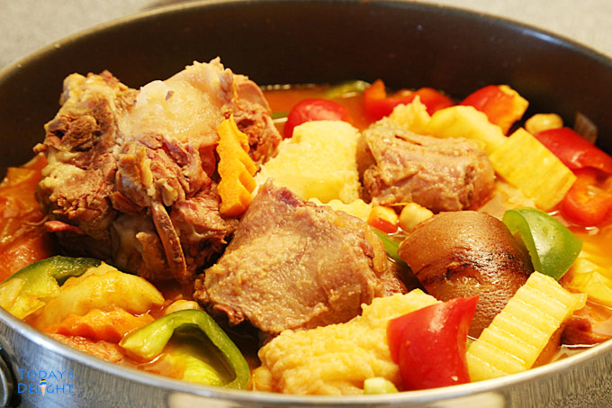 Oxtail, tripe, smoke pork hock and vegetables in pan